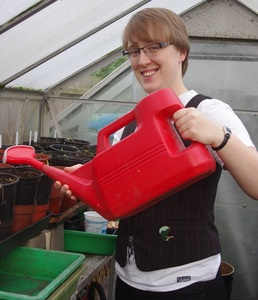 Linda with watering can